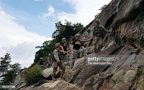 YONAH GEORGIA JULY 14 2015 A twoperson team of Ranger students including a woman at left receive guidance from a Ranger instructor on Mount Yonah in...