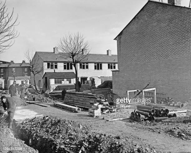 Twostorey homes under construction on the Lansbury Estate in Poplar east London England April 1951 The development by the London County Council is...