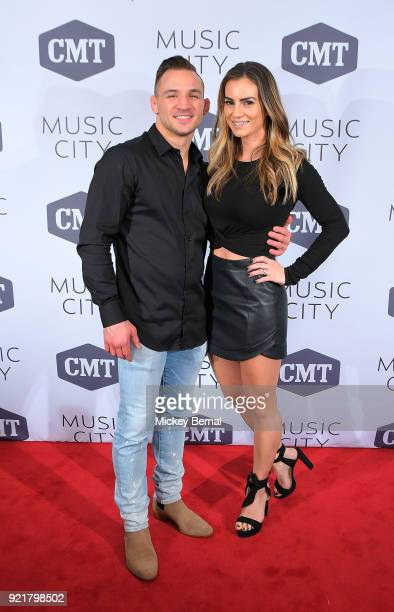 Twotime Bellator Lightweight Champion Michael Chandler and wife Brie Willett attend CMT's 'Music City' premiere party at The Back Corner on February...