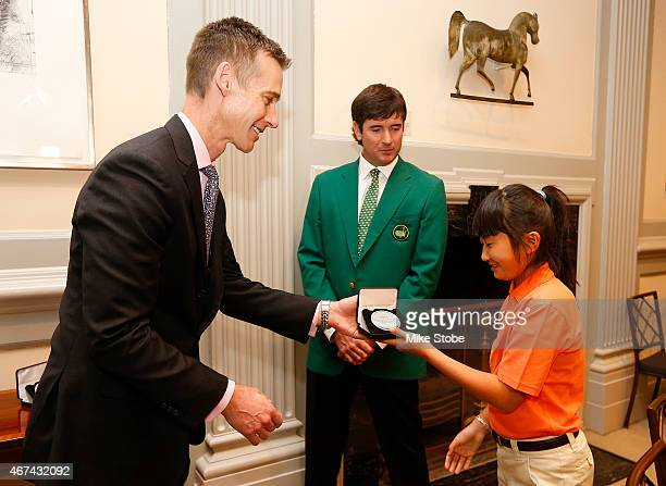 Twotime defending Masters Champion Bubba Watson and defending Drive Chip Putt National Champion 10year old Kelly Xu exchange gifts with Vice...