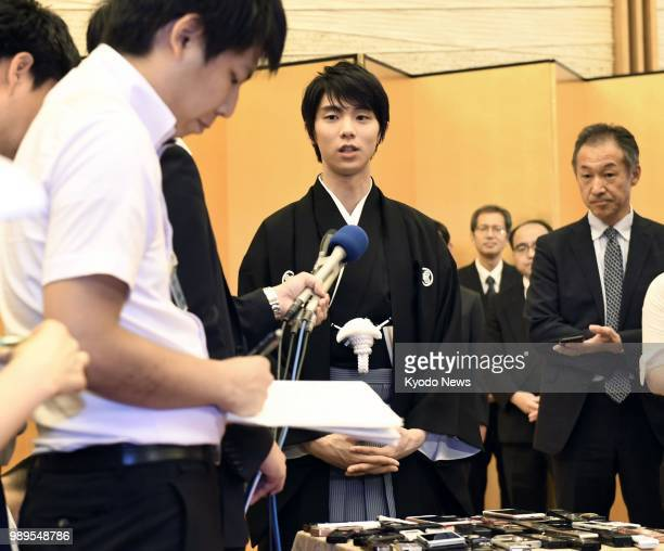 Twotime figure skating Olympic gold medalist Yuzuru Hanyu answers questions from the press after receiving the People's Honor Award at a ceremony at...
