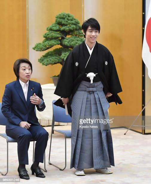 Twotime figure skating Olympic gold medalist Yuzuru Hanyu attends a ceremony to receive the People's Honor Award at a ceremony at the premier's...