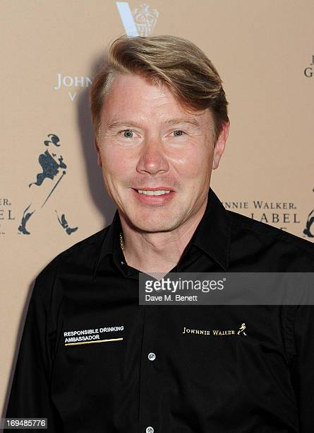 Twotime Formula One World Champion Mika Hakkinen attends the Johnnie Walker Gold Label Reserve cocktail party aboard the John Walker Sons Voyager in...
