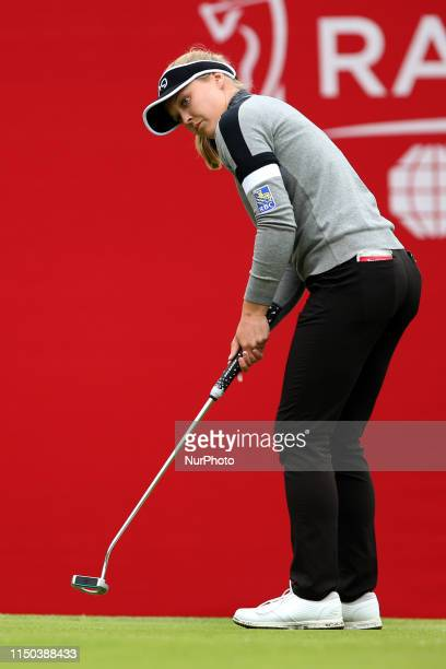 Twotime Meijer LPGA Classic by Simply Give champion Brooke Henderson of Smith Falls Ontario follows her putt on the 18th green before going on to win...