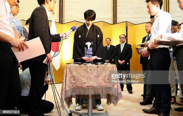 Twotime Olympic figure skating Men's Singles gold medalist Yuzuru Hanyu responds questions from reporters after the People's Honour Award ceremony at...