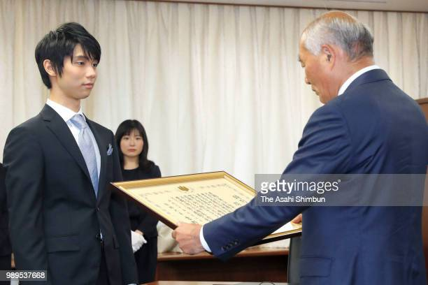 Twotime Olympic figure skating Men's Singles gold medalist Yuzuru Hanyu receives certificate of appreciation from the Reconstriction Minister...