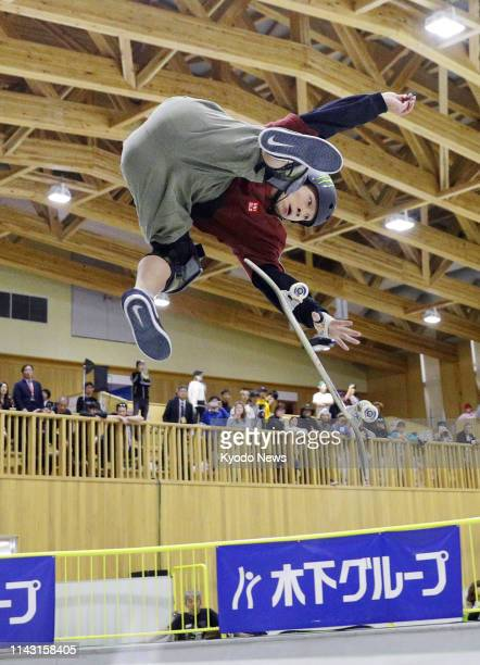 Twotime Olympic snowboard silver medalist Ayumu Hirano performs en route to winning the men's park event at the national championships at Murakami...