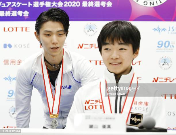 Twotime reigning Olympic champion Yuzuru Hanyu is pictured with Yuma Kagiyama after Japan's national figure skating championships in Tokyo on Dec 22...