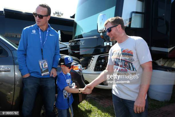 Twotime Super Bowl winning quarterback and honorary pace car driver Peyton Manning and his son Marshall meet former NASCAR driver Dale Earnhardt Jr...