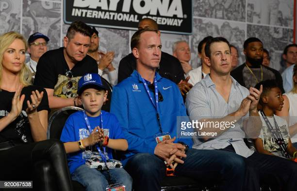 Twotime Super Bowl winning quarterback Peyton Manning and his son Marshall during the drivers meeting for the Monster Energy NASCAR Cup Series 60th...