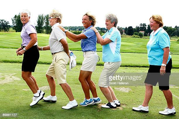 Twotime US Team Captain Patty Sheehan leads Pat Bradley Pia Nilsson Alice Miller and Joanne Carner in the bunny hop at a past Solheim Cup Captain's...