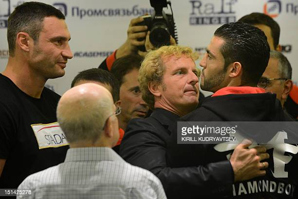 Twotime WBC World Heavyweight Champion Vitali Klitschko from the Ukraine and his challenger Manuel Charr from Germany stand face to face during a...