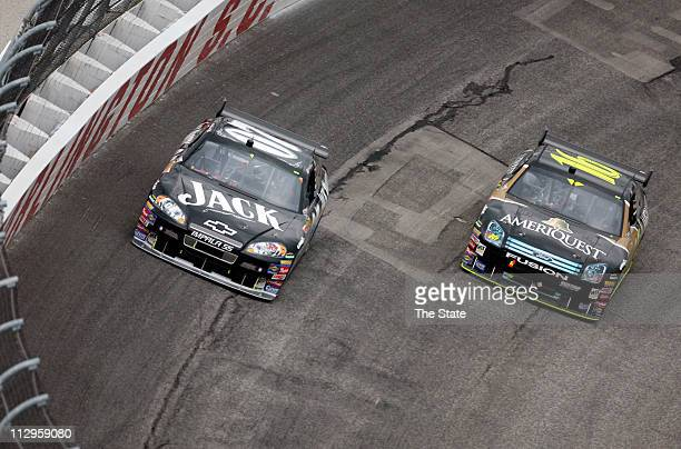 Two-time winner Greg Biffle looks to pass pole sitter Clint Bowyer on lap five of the Dodge Avenger 500 at Darlington Raceway in Darlington, South...
