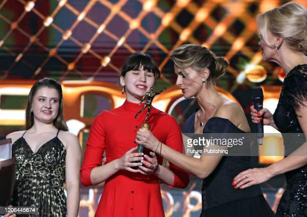 KYIV UKRAINE MARCH 9 2020 Twotime world swimming champion Maryna Piddubna accepts the Strong in Spirit award during the Heroes of Sports Year 2019...