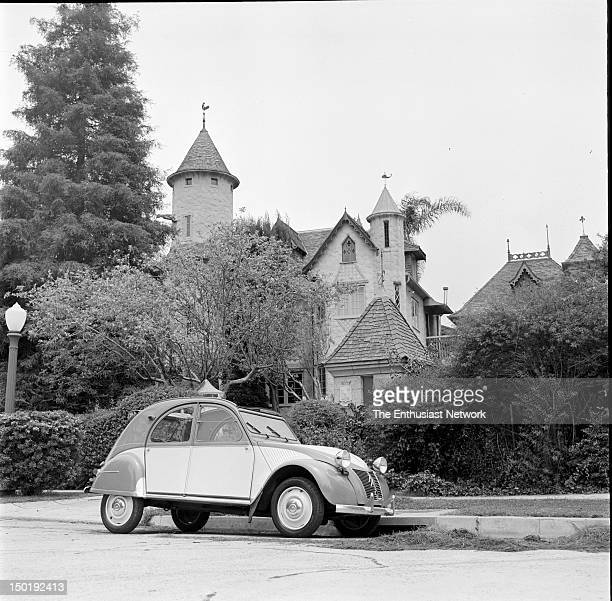 Twotone 1955 Citroen 2CV parked outside of a rustic home in the Los Angeles suburbs