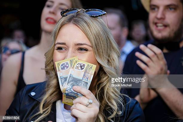 Twoup at the Gelnmore Hotel in the Rocks on April 25 2016 in Sydney Australia Twoup is a traditional Australian gambling game made popular among...