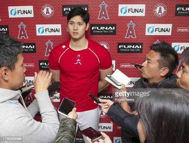 Twoway player Shohei Ohtani speaks to reporters at the Los Angeles Angels' spring training complex in Tempe Arizona on March 13 2019 ==Kyodo