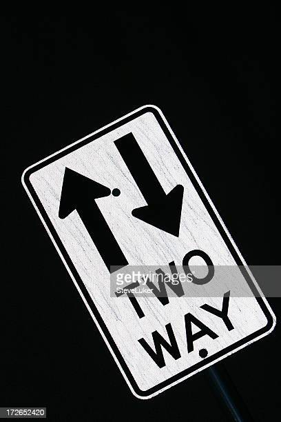 two-way street sign. - double arrow stock pictures, royalty-free photos & images