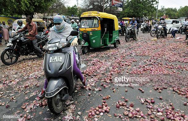 A twowheeler rider struggles in front of Collectorate where onions were thrown by farmers from Bijalpur and Rau as part of their protest on May 30...