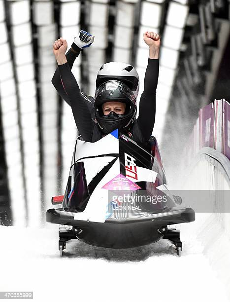 US2 twowoman bobsleigh pilot Jamie Greubel and brakewoman Aja Evans celebrate in the Women's Bobsleigh Heat 4 and final run at the Sliding Center...