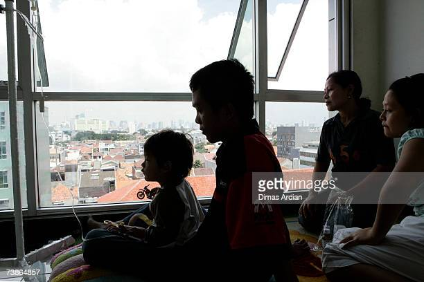 Twoyearold Adam a Dengue Fever sufferer is treated in the corridor of the Tarakan General Hospital on April 12 2007 in Capital City Jakarta Indonesia...