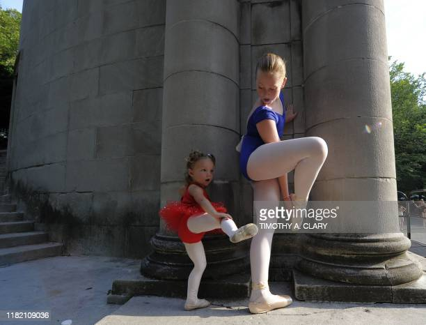 Two-year-old Ava Baraket and Carlyann Welch warm up as they prepare to stand en pointe for one minute in an attempt to enter the Guinness Book of...