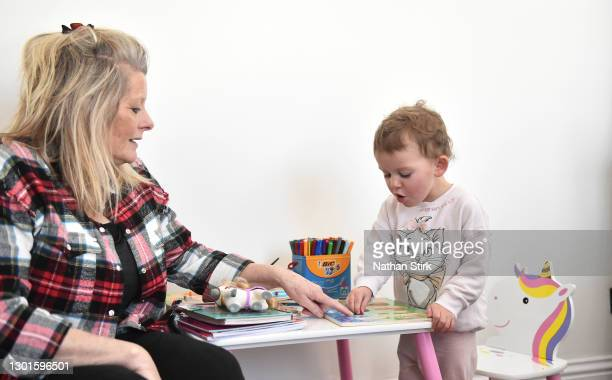Two-year-old Blossom Walker, who is the photographer's niece, takes part in educational activities at her home by her Grandparent, Claire Stirk on...