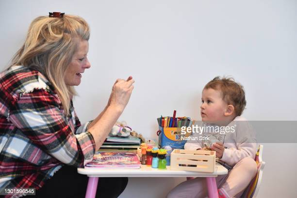 Two-year-old Blossom Walker, who is the photographer's niece, takes part in educational activities at her home by her Grandparent Claire Stirk on...
