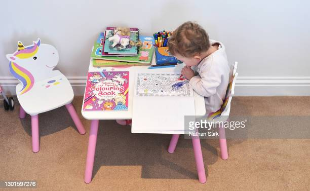 Two-year-old Blossom Walker, who is the photographer's niece, takes part in educational activities at her home on February 11, 2021 in Bradford,...