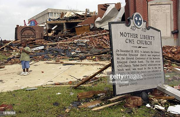 Twoyearold Clarence Adams Jr stands near the rubble of the historic Mother Liberty CME Church May 6 2003 in Jackson Tennessee Tornadoes on Sunday cut...