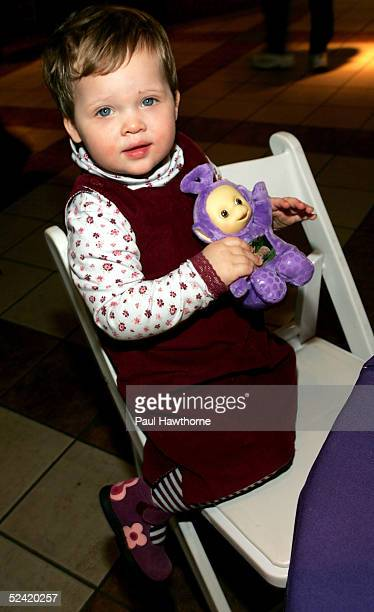Twoyearold Genevieve Livingstone of Brooklyn holds Tinkie Winkie as she attends the 'Teletubbies' Movie Premiere for 'Reel Moms' at Loews 34th Street...
