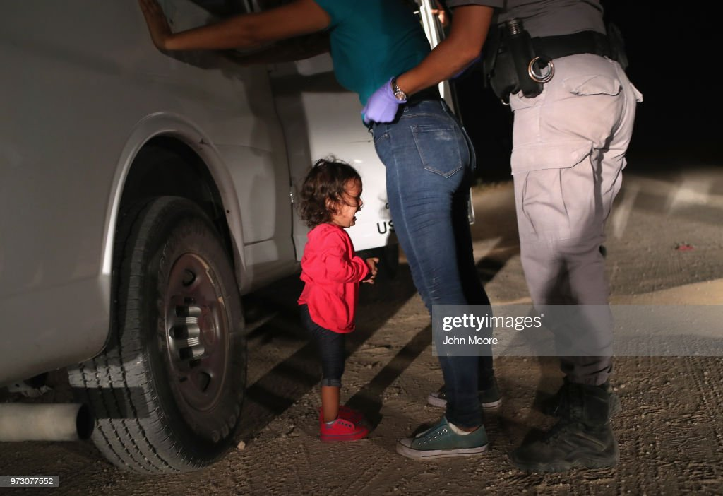 A two-year-old Honduran asylum seeker cries as her mother is searched and detained near the U.S.-Mexico border on June 12, 2018 in McAllen, Texas. The asylum seekers had rafted across the Rio Grande from Mexico and were detained by U.S. Border Patrol agents before being sent to a processing center for possible separation. Customs and Border Protection (CBP) is executing the Trump administration's 'zero tolerance' policy towards undocumented immigrants. U.S. Attorney General Jeff Sessions also said that domestic and gang violence in immigrants' country of origin would no longer qualify them for political asylum status.