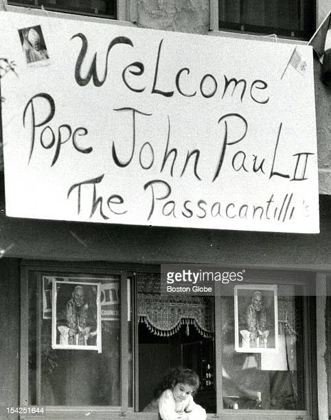Twoyearold Maria Renda looked out a window below a banner from the Passacantilli family welcoming Pope John Paul II to the North End