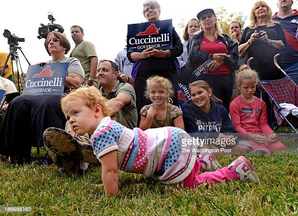 Twoyearold Regina Pennefather seeks to get a better view of Wisconsin Governor Scott Walker and Virginia Gubernatorial candidate Ken Cuccinelli at a...