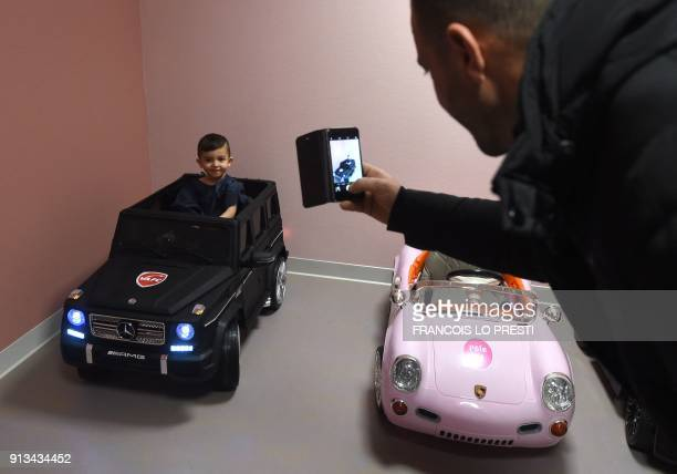 Twoyearold Souhail is photographed by his father as he sits in an electric toy car on his way to the operating room at the Valenciennes Hospital in...