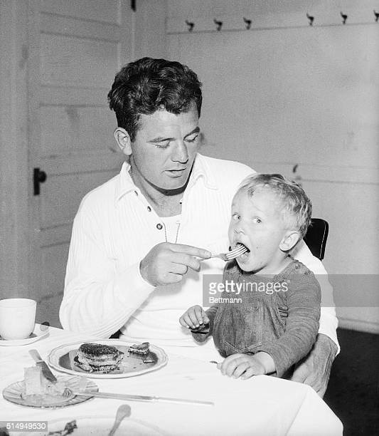 Twoyearold Tommy Rynd of Golfmore Resort Wisc has attached himself to champion Jimmy Braddock and even eats breakfast with the champ as this photo...