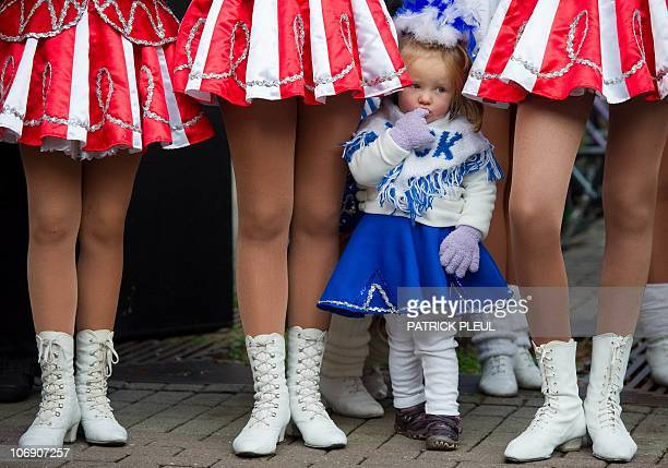 Twoyears old majorette Nina waits with members of her dance group on November 11 2010 in Cottbus Carnival revellers across the country and mainly the...
