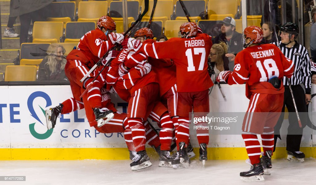 Ty Amonte #3 of the Boston University Terriers celebrates his goal in double overtime against the Harvard Crimson with his teammates during NCAA hockey in the semifinals of the annual Beanpot Hockey Tournament at TD Garden on February 5, 2018 in Boston, Massachusetts. The Terriers won 3-2 in double overtime.