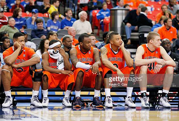 Ty Armstrong, Josh Wallace, Tony Neysmith, Josh Langford and Rob Chubb of the Auburn Tigers react during their 51 to 69 loss to the Georgia Bulldogs...