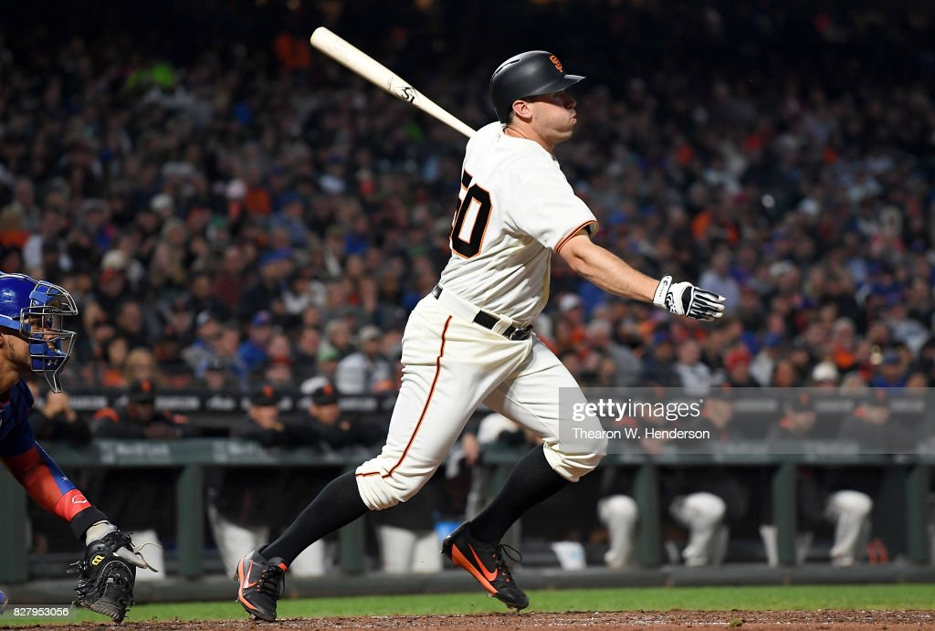 Ty Blach #50 of the San Francisco Giants hits an RBI single scoring Brandon Crawford #35 against the Chicago Cubs in the bottom of the fourth inning at AT&T Park on August 8, 2017 in San Francisco, California.
