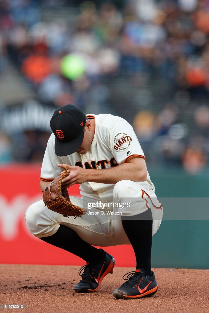 Ty Blach #50 of the San Francisco Giants squats on the pitchers mound during the first inning against the Oakland Athletics at AT&T Park on August 3, 2017 in San Francisco, California. The San Francisco Giants defeated the Oakland Athletics 11-2.