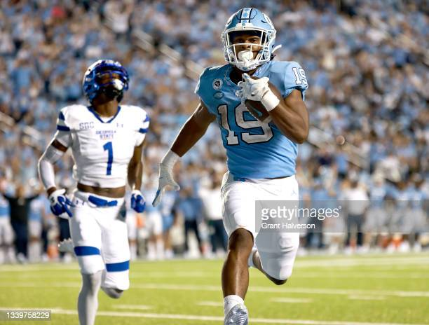Ty Chandler of the North Carolina Tar Heels beats Jontrey Hunter of the Georgia State Panthers to the end zone for a touchdown during the second half...