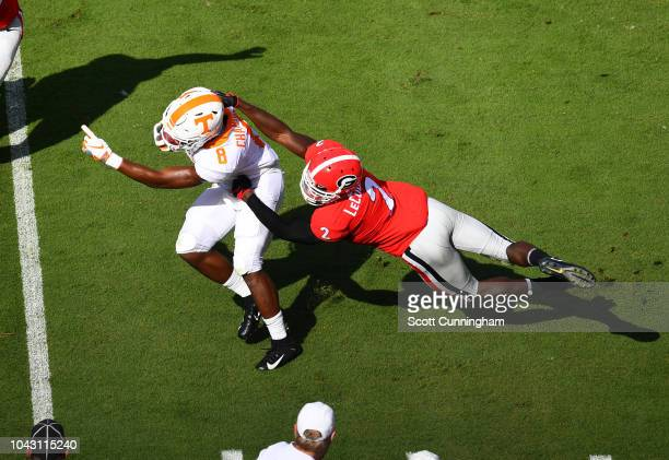 Ty Chandler of the Tennessee Volunteers carries the ball against Richard LeCounte of the Georgia Bulldogs at Sanford Stadium on September 29 2018 in...