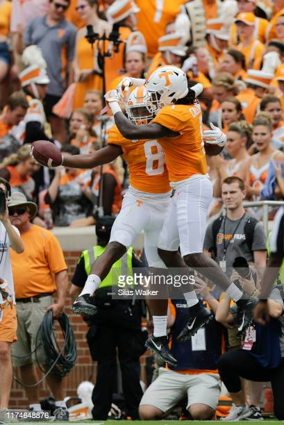 Ty Chandler of the Tennessee Volunteers celebrates scoring a touchdown against the Chattanooga Mockingbirds during the first quarter at Neyland...