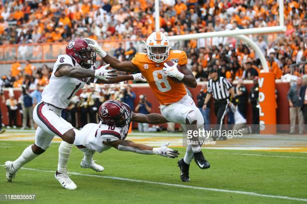 Ty Chandler of the Tennessee Volunteers runs with the ball against the South Carolina Gamecocks during the second quarter at Neyland Stadium on...