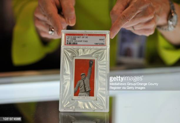 Ty Cobb baseball card worth $75000 at the Long Beach Coin Stamp Sports Collectibles Expo on September 6 2012 The card is one of nine rare baseball...