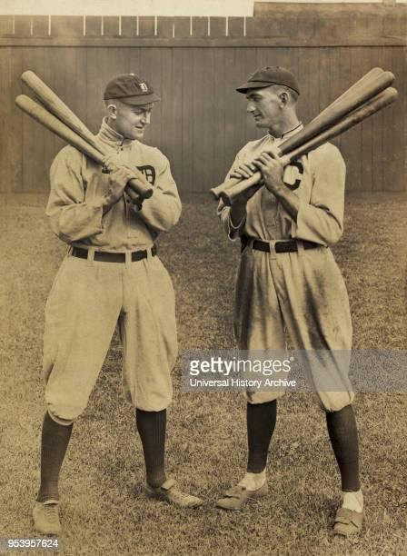Ty Cobb Detroit and Joe Jackson Cleveland standing alongside each other each holding bats by L Van Oeyen 1913