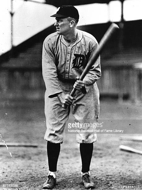 Ty Cobb of the Detroit Tigers poses with a bat