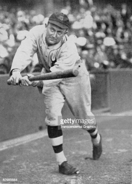 Ty Cobb of the Detroit Tigers takes a batting pose at Navin Field in Detroit before a game in 1923.