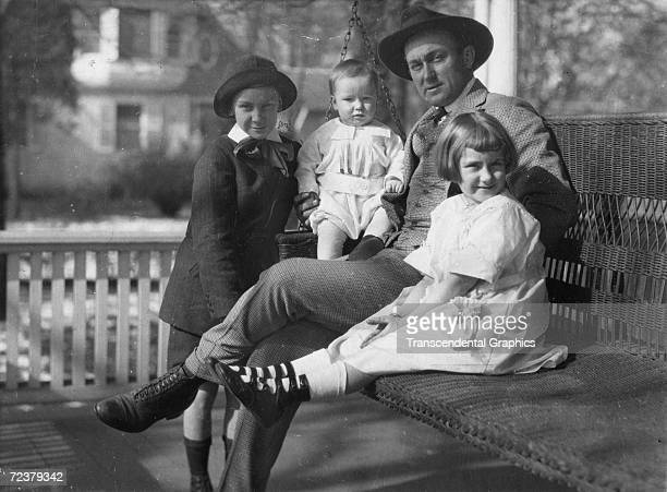 ATLANTA JANUARY 27 1913 Ty Cobb outfielder for the Detroit Tigers sits on his porch swing in Atlanta with his children early in January of 1913